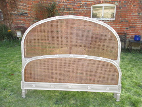 Large caned bed