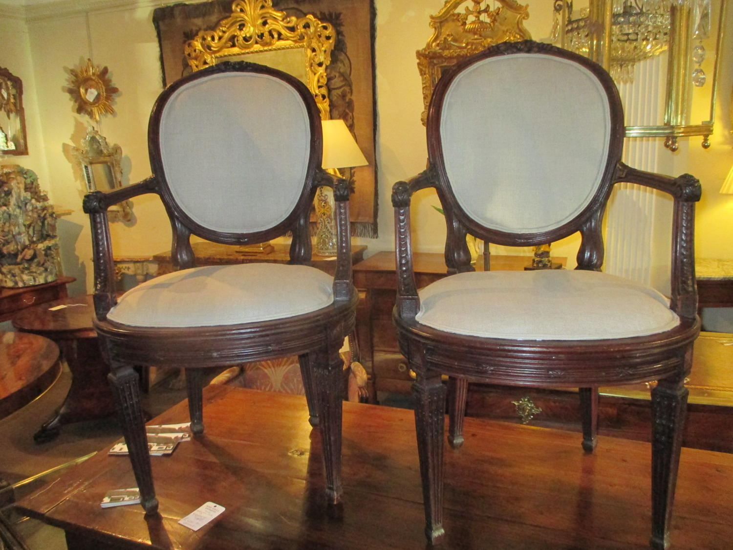 Pair of carved mahogany armchairs