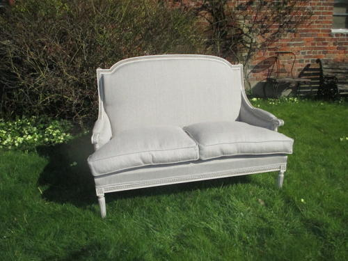 Painted two seater sofa in linen