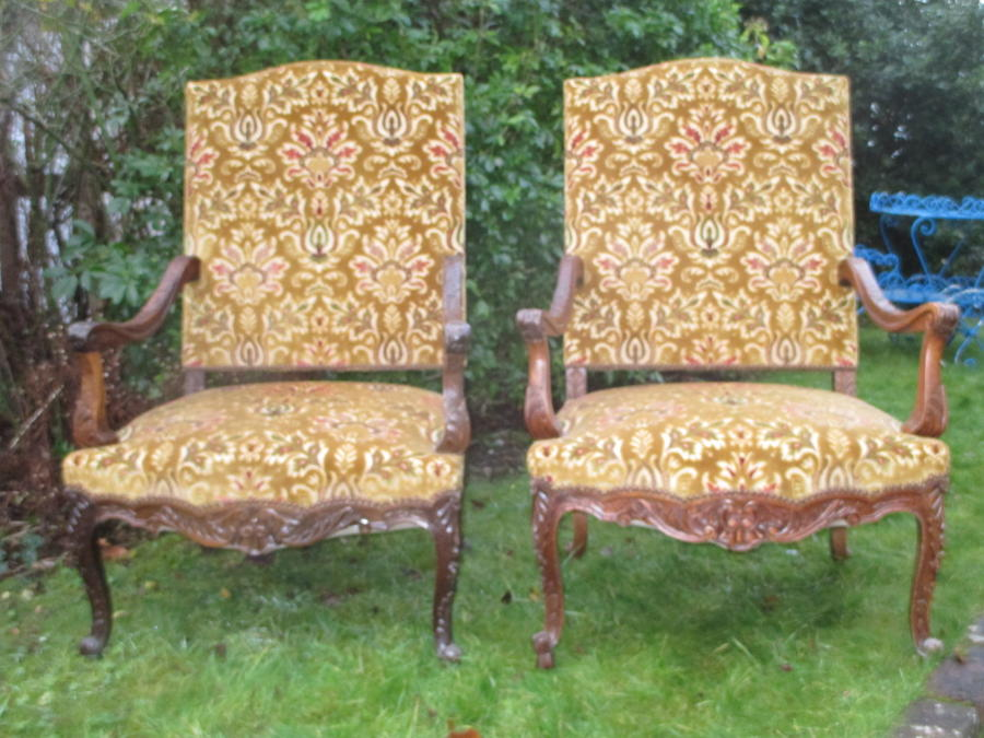 Pair of large carved walnut armchairs