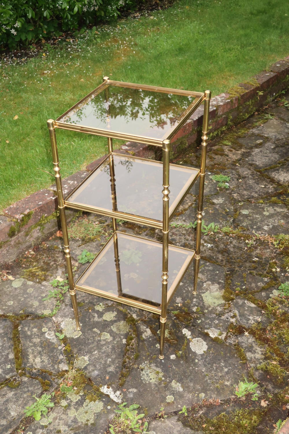 Brass and smoked glass etagere.