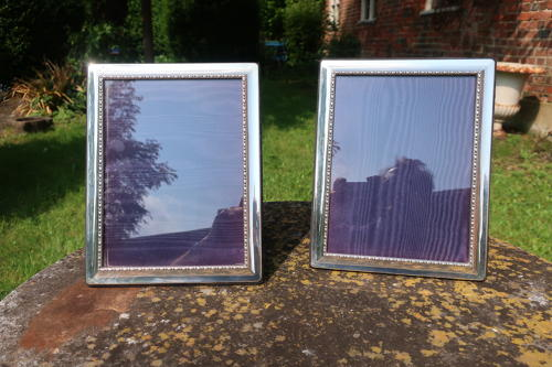 Pair of silver photo frames
