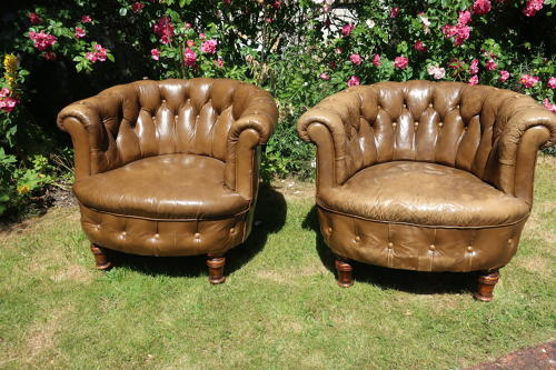 Pair of leather button back chairs