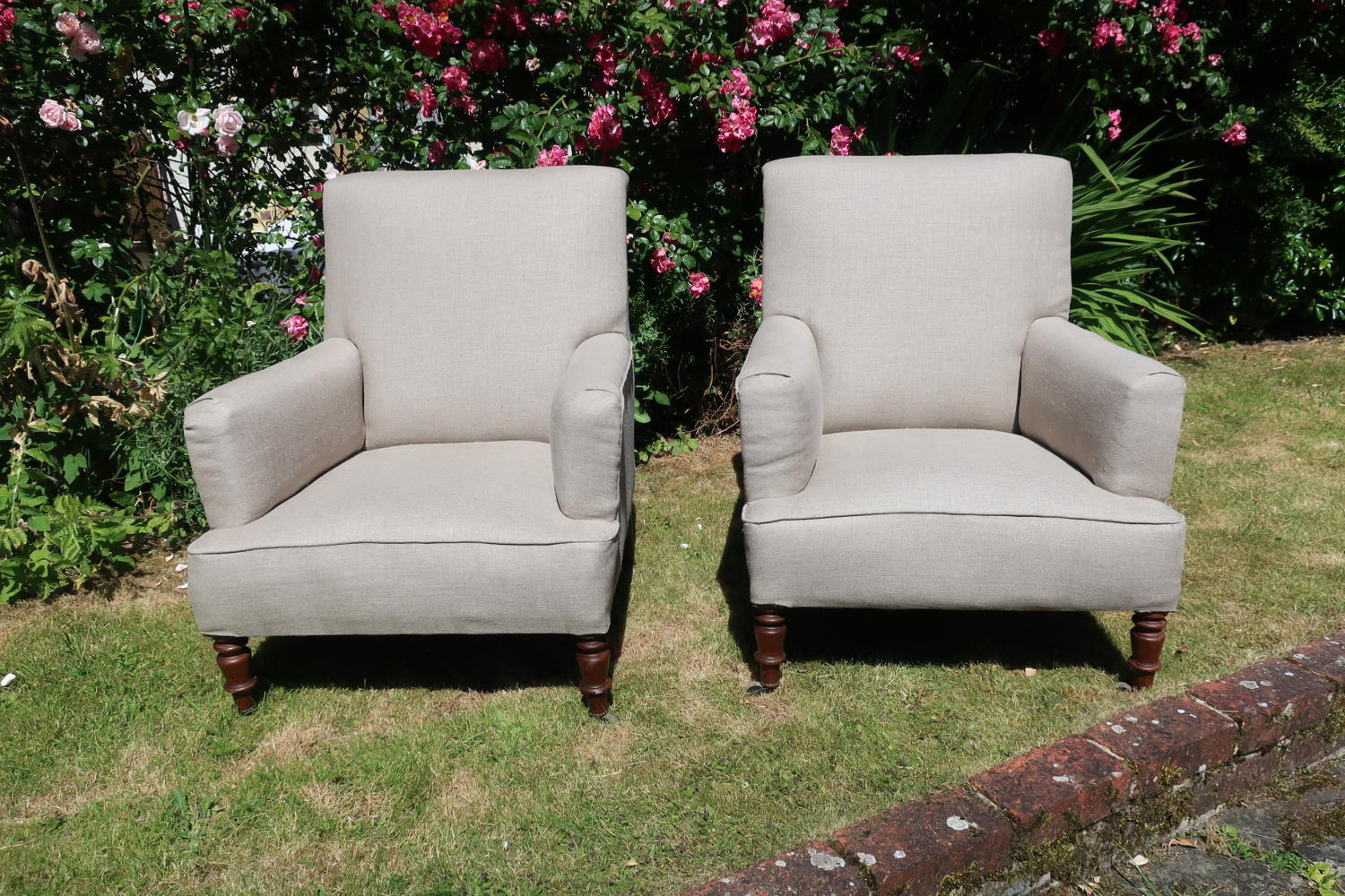 Pair of antique upholstered armchairs