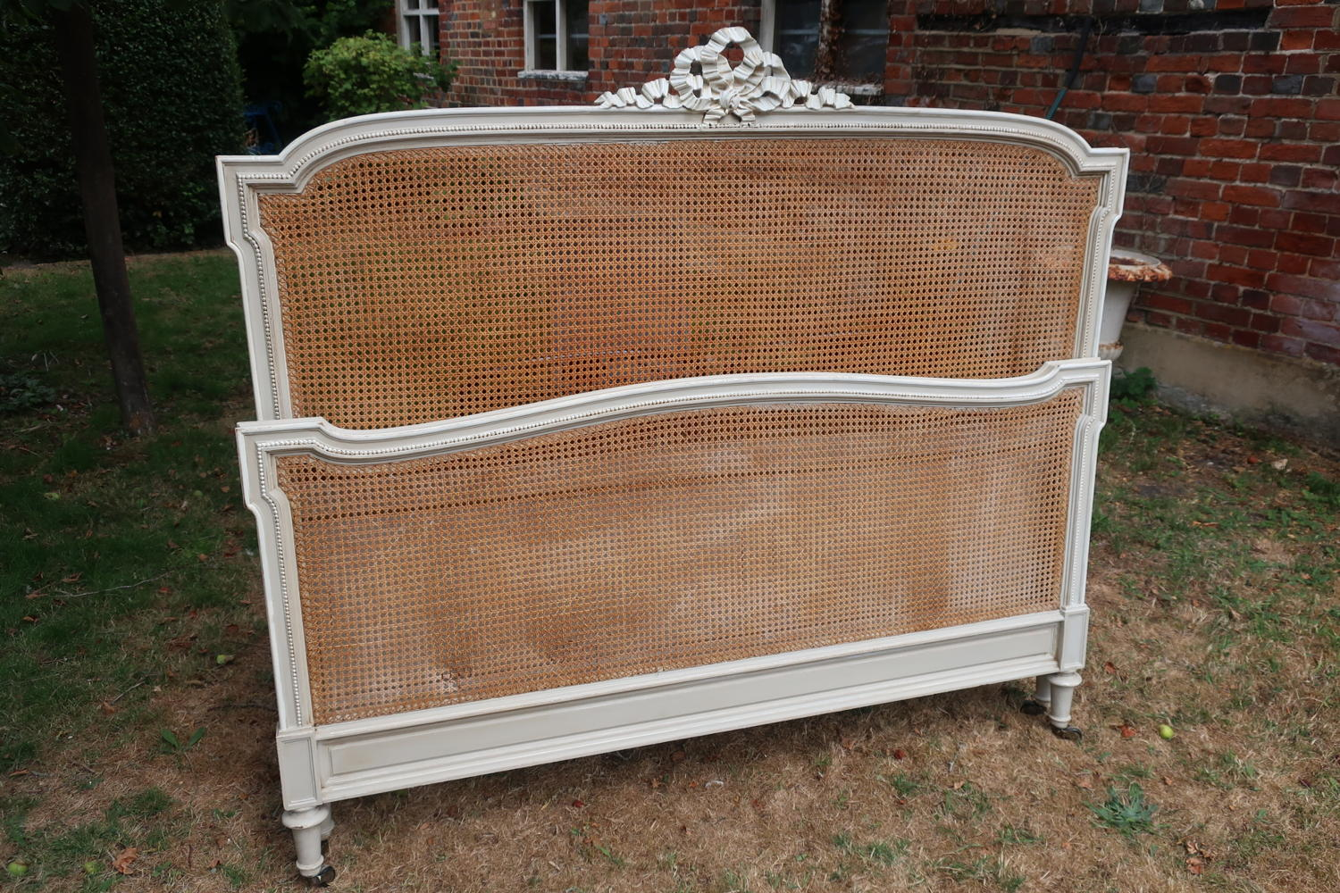 Painted caned bed