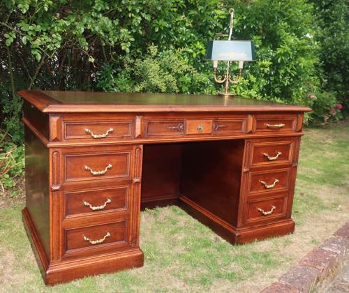 Large walnut pedestal desk