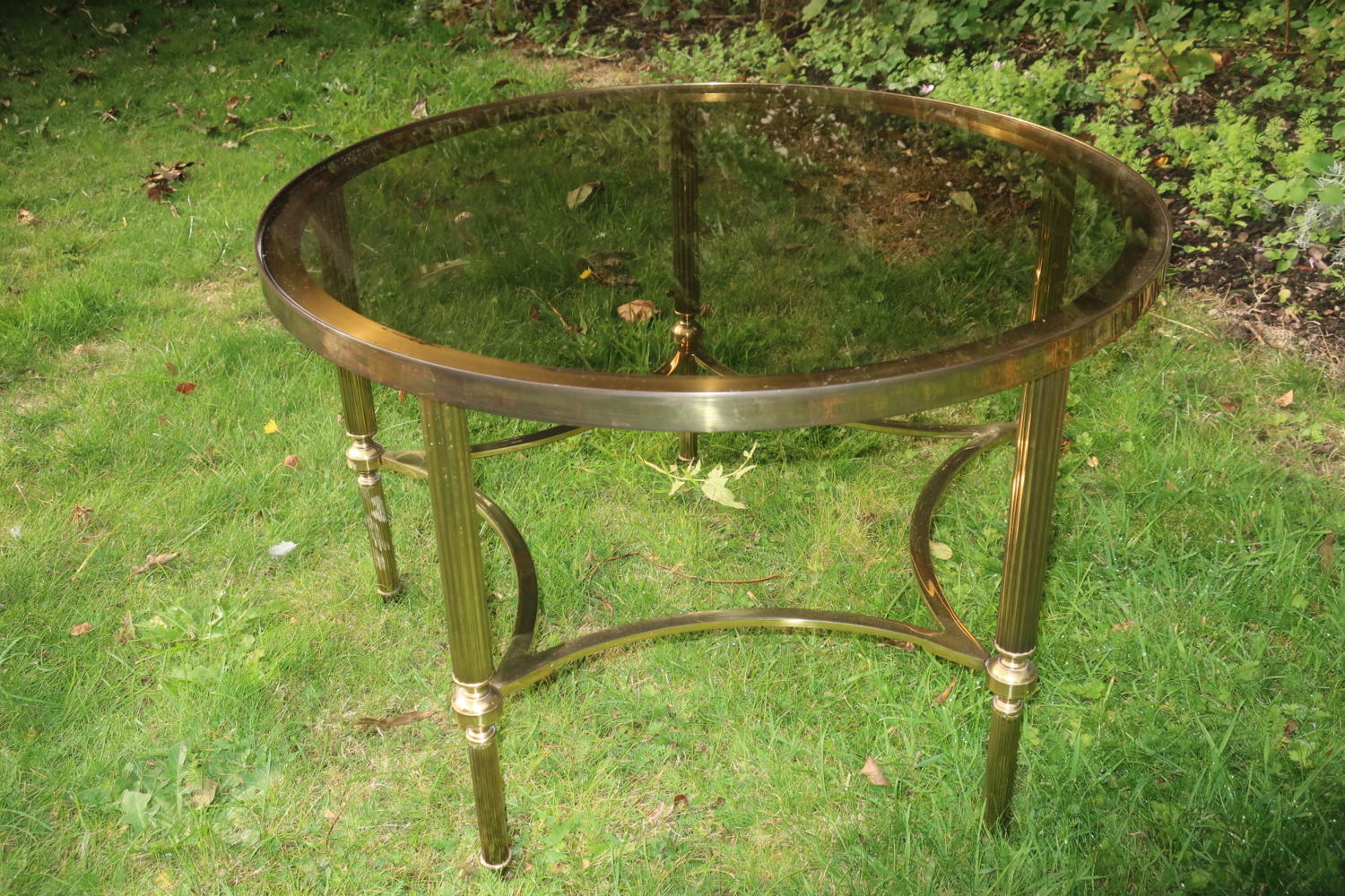 Mid 20th Century brass and smoked glass coffee table