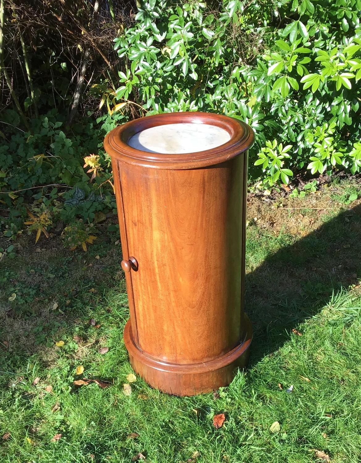 Cylindrical mahogany bedside table