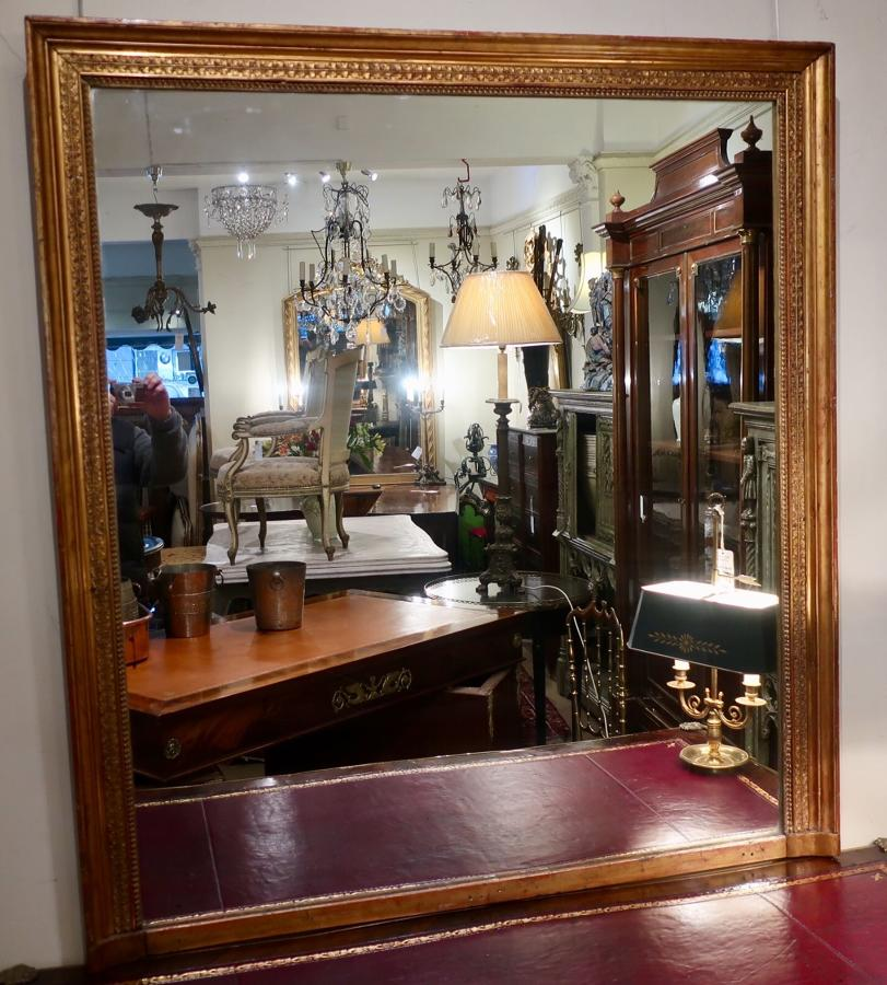 Large and wide gilt mirror