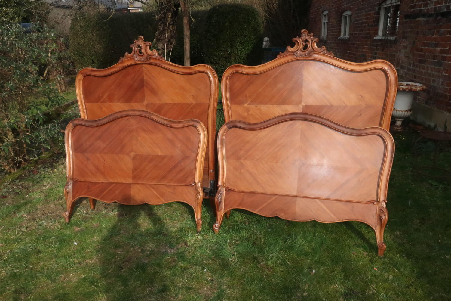 Pair of walnut single beds