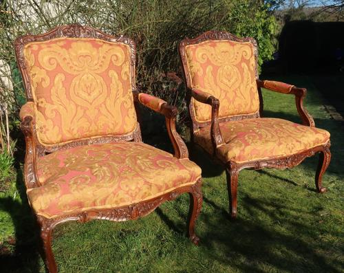 Pair of large scale French Walnut armchairs