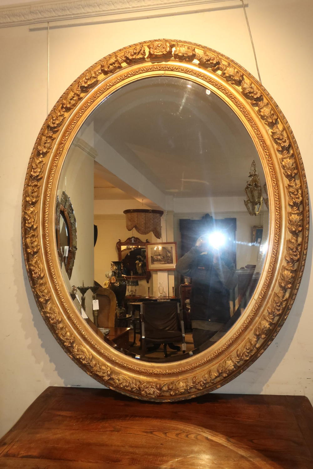 A very large oval gilt mirror