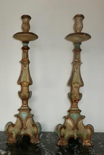 Pair of painted carved wood candlesticks