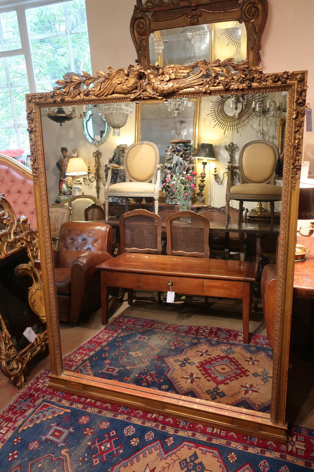Large gilt mirror with lovebirds
