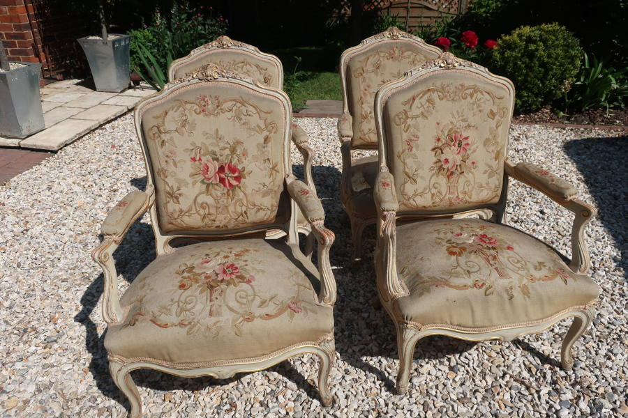 Four needlepoint armchairs
