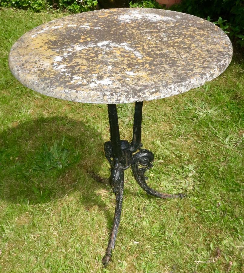 Wrought iron marble topped garden table