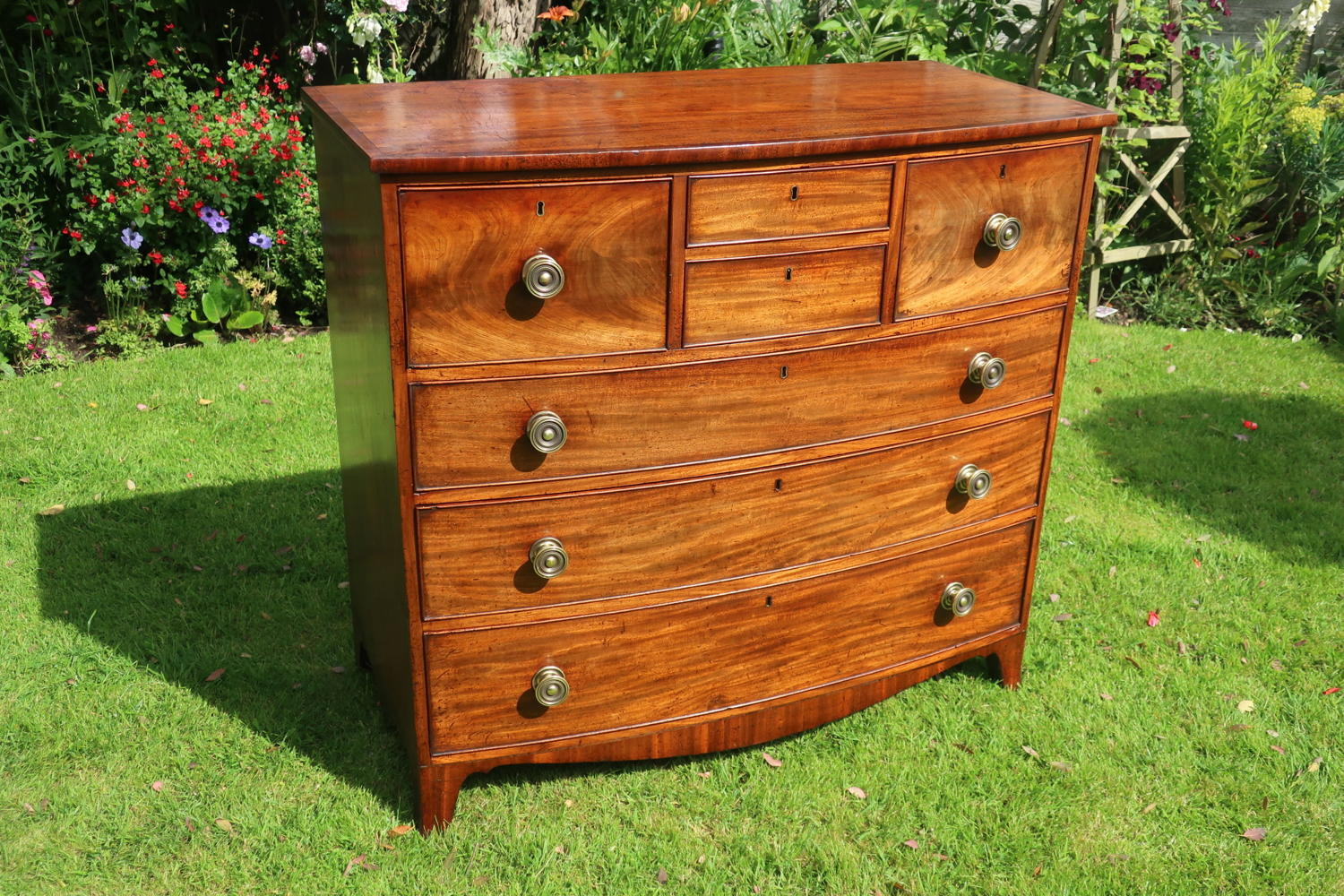 Georgian bow front chest of drawers in flame mahogany