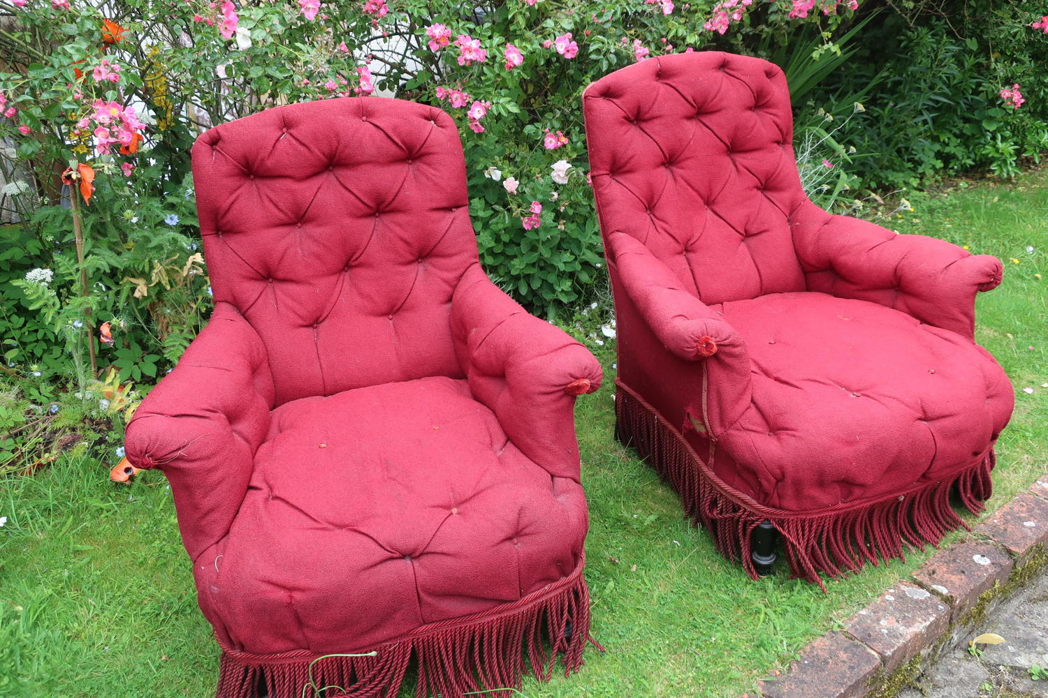 Pair of large button back French armchairs