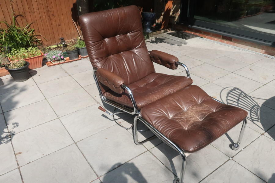 70's chromed steel and brown leather armchair and stool