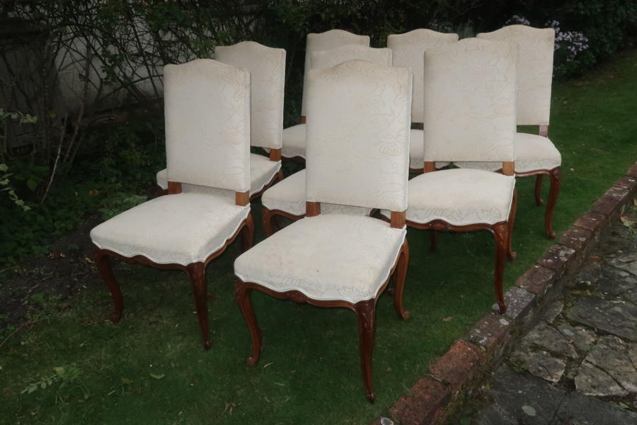 Set of eight carved walnut dining chairs