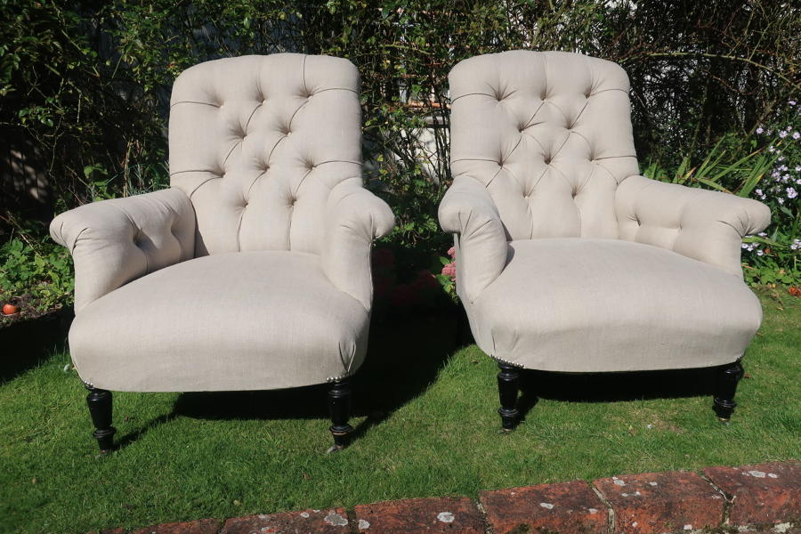 Pair of large button back armchairs
