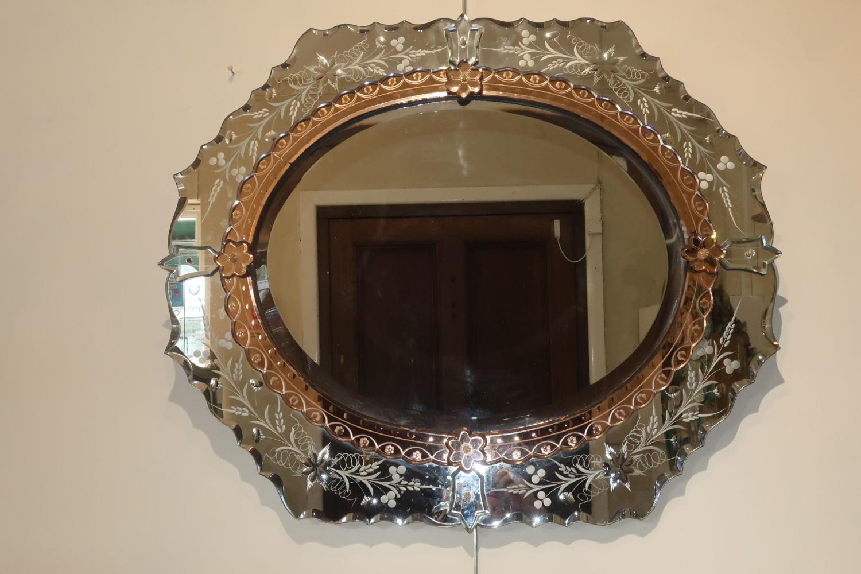An etched Venitian mirror.