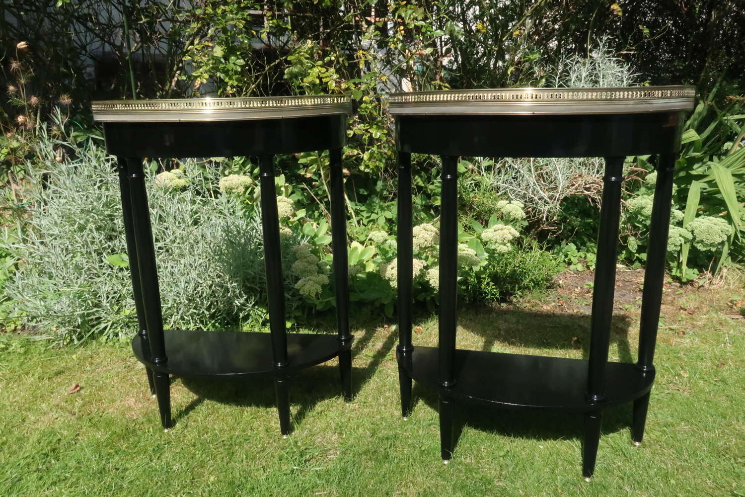 Pair of ebonised small console or side tables