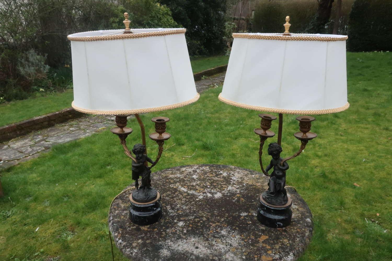 Pair of bronze cherub lamps