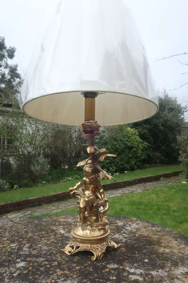 Signed gilt bronze cherub lamp