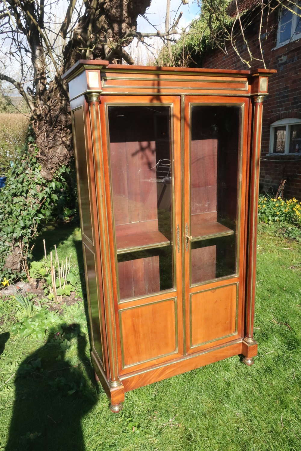 Mahogany and brass bookcase
