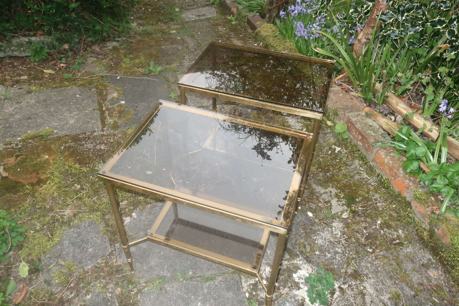 Pair of mid century glass and brass tables