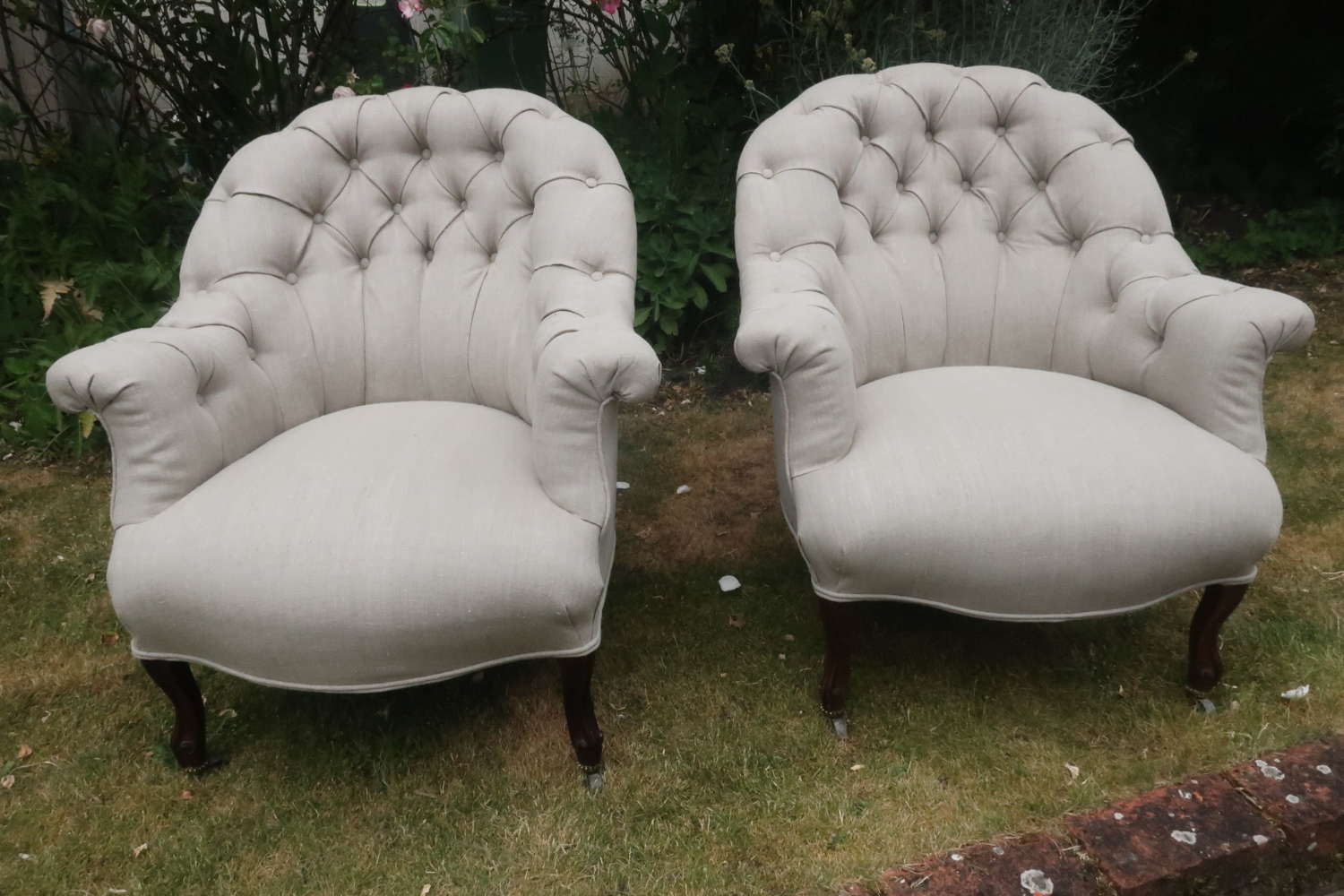 Pair of button back rosewood armchairs