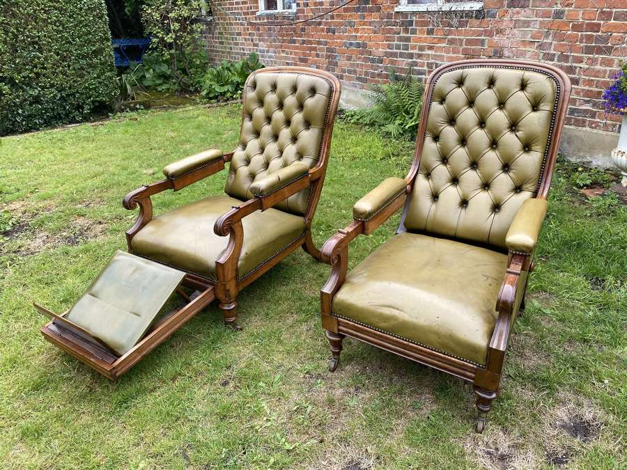Matched pair of patent reclining armchairs in green leather