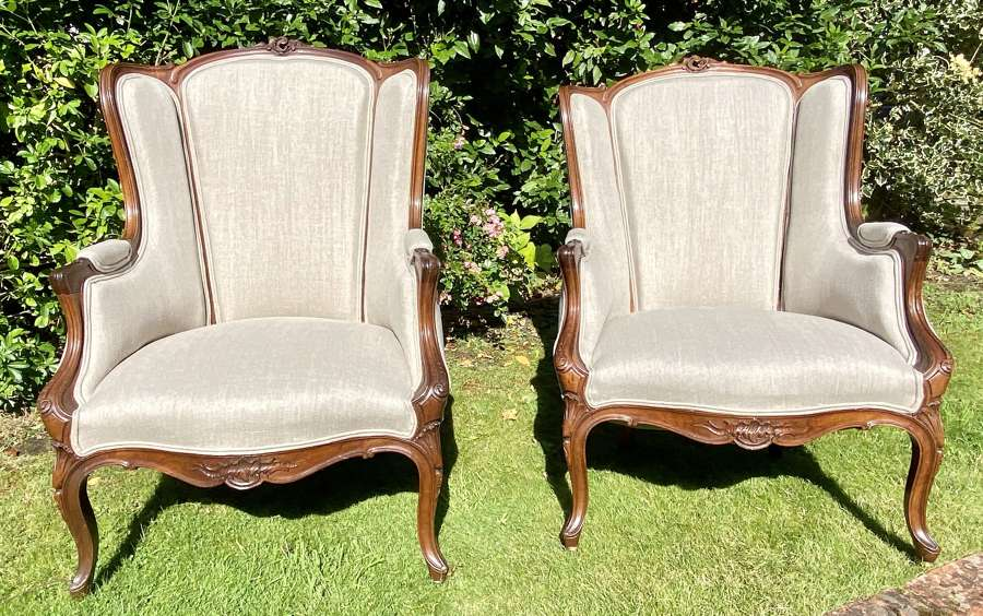 Large pair of French carved walnut armchairs