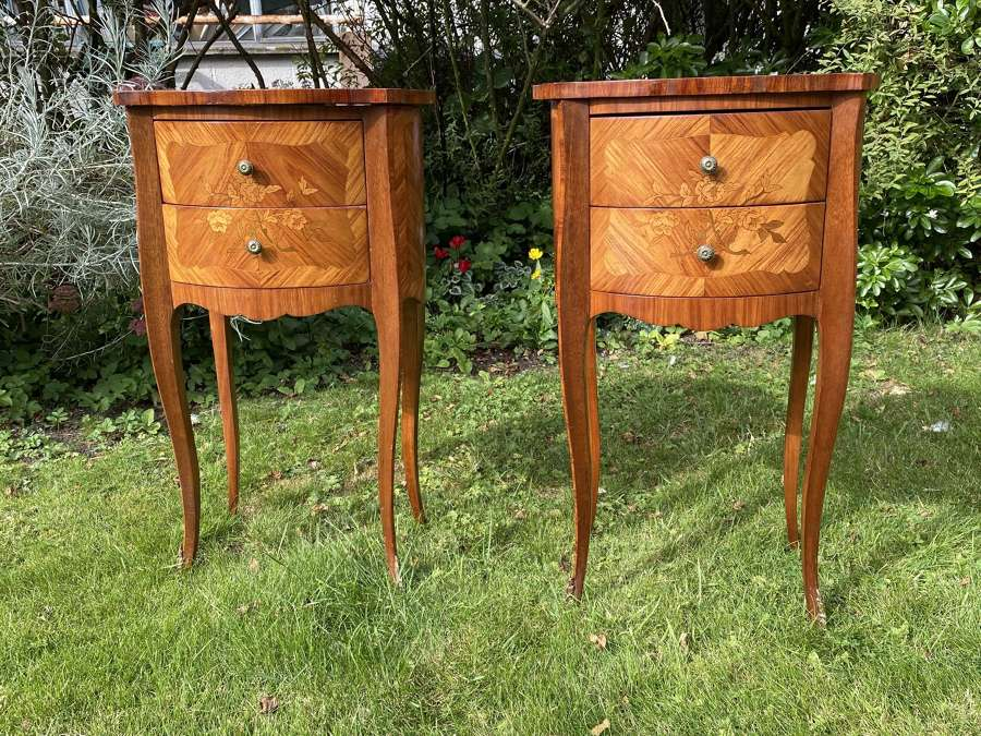 A pair of French marquetry bedside tables