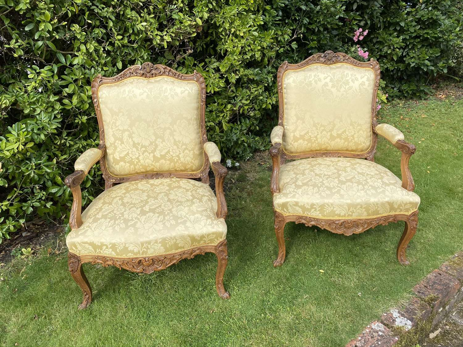 Pair of carved walnut armchairs