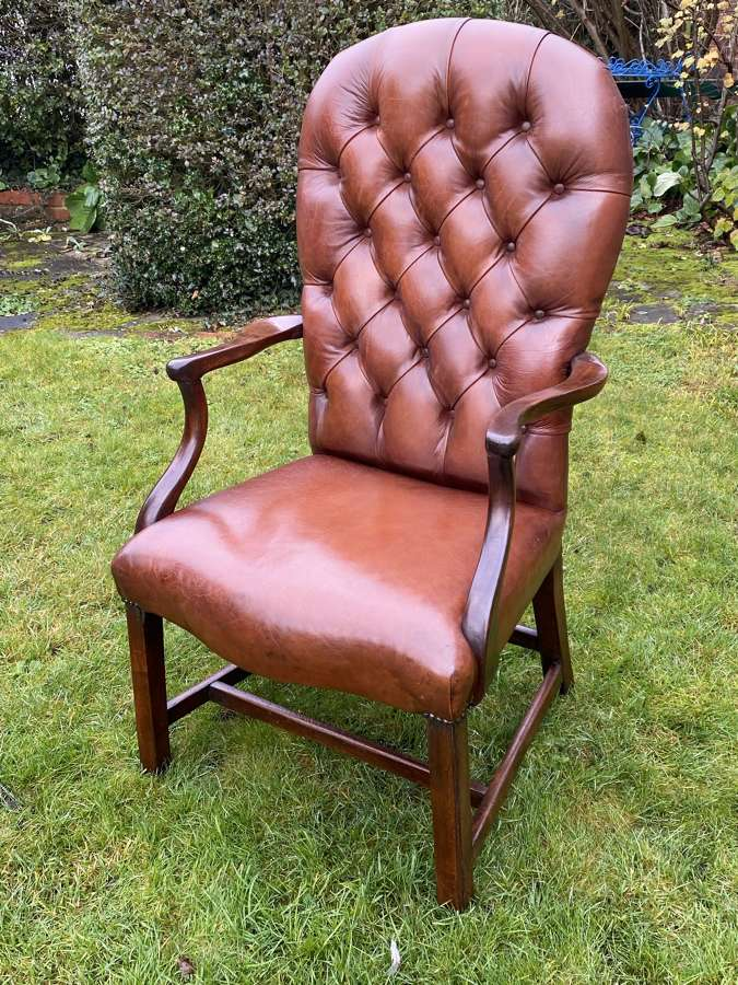 Button back leather armchair
