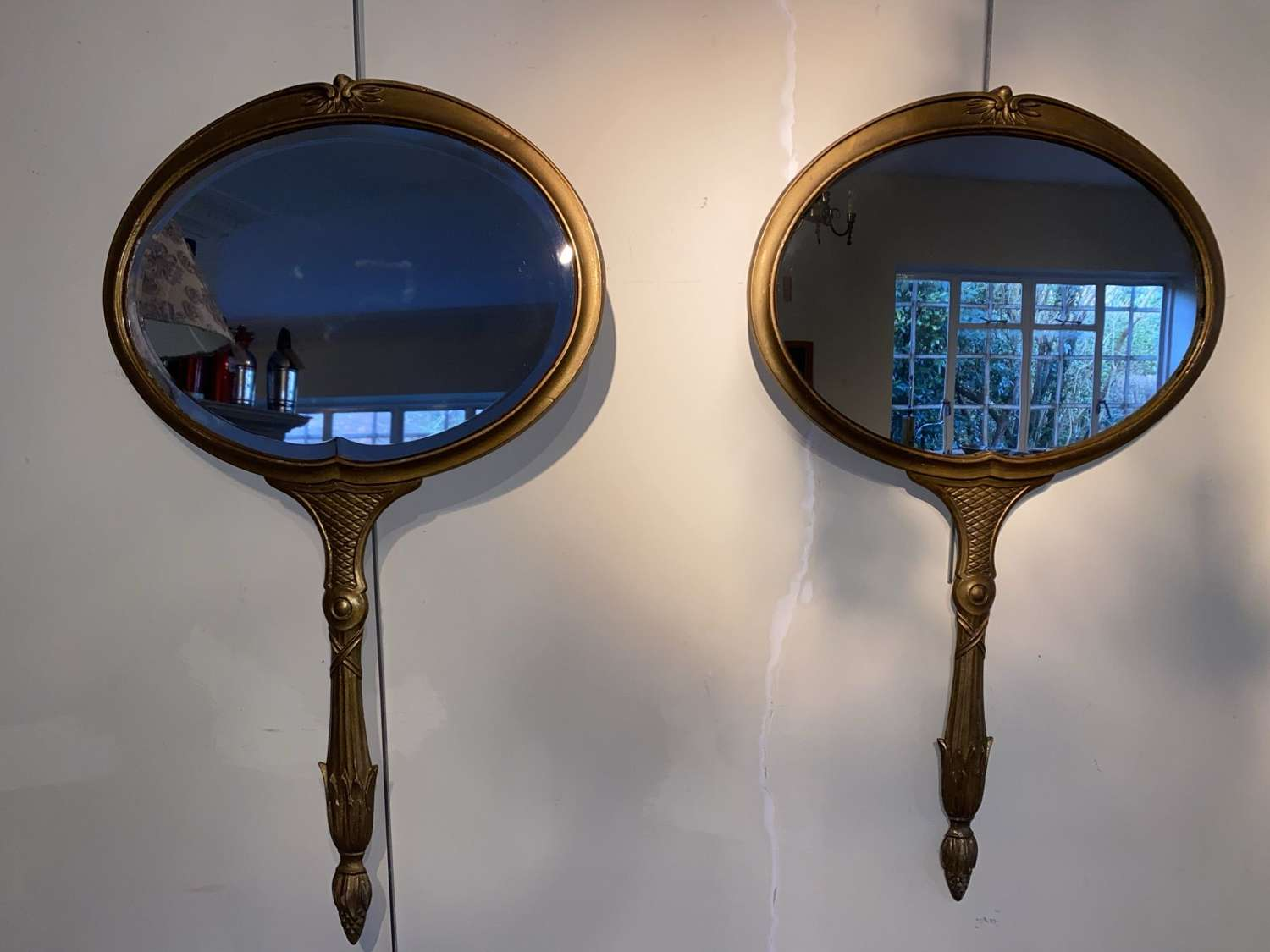 Unusual pair of Italian metal looking glass mirrors