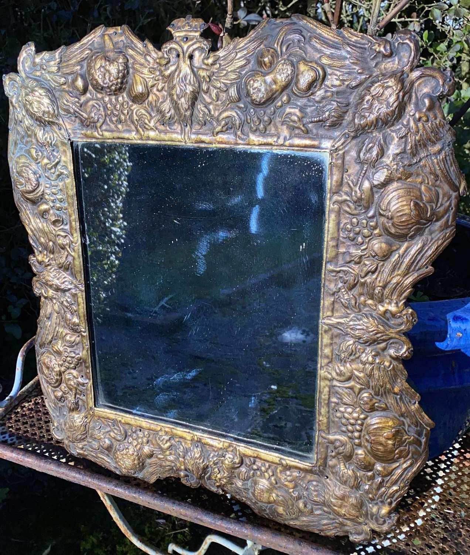 Brass repousse mirror