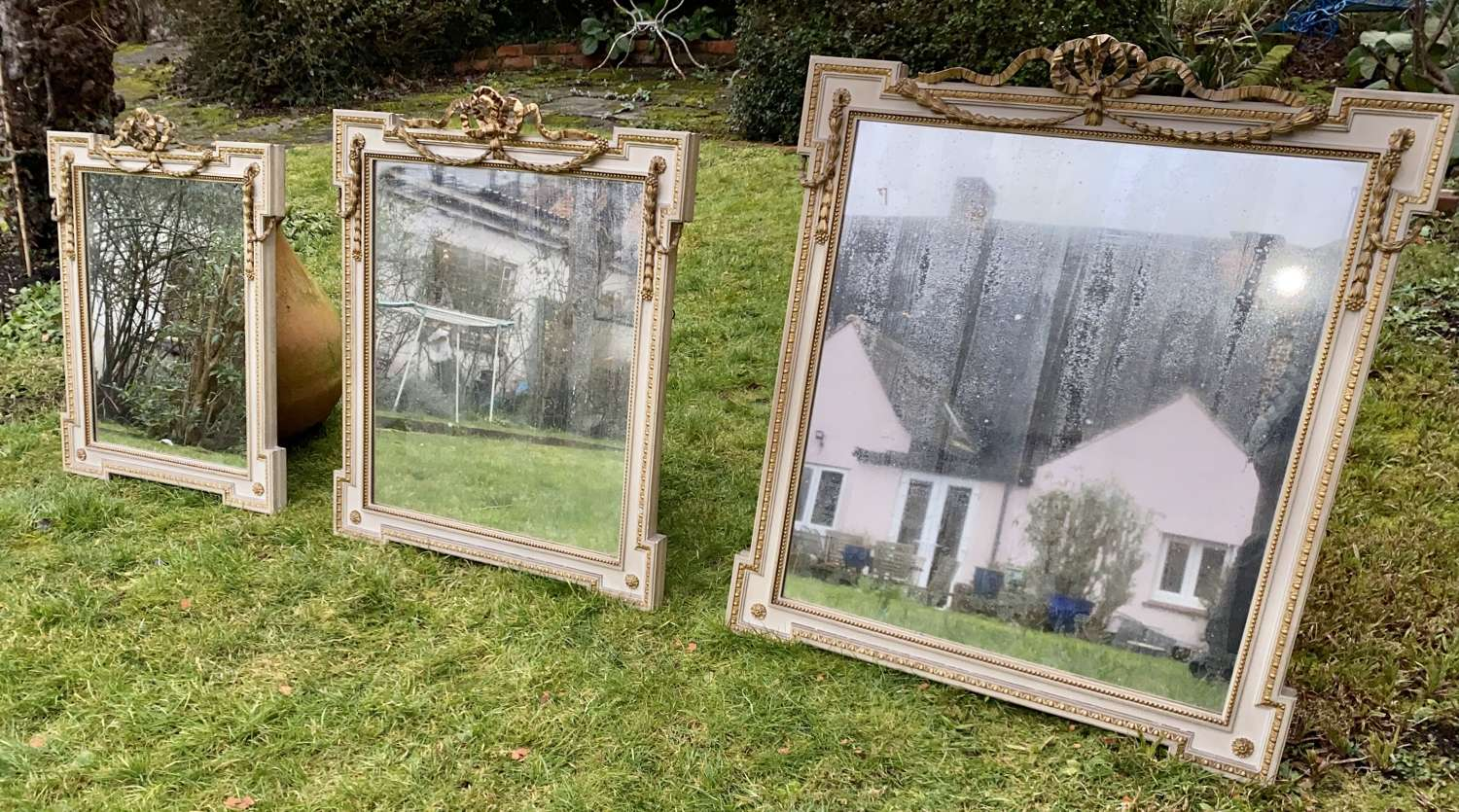 Set of three painted and gilt mirrors