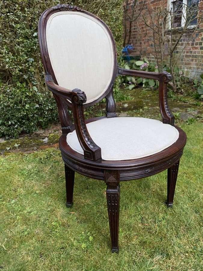 Carved mahogany armchair