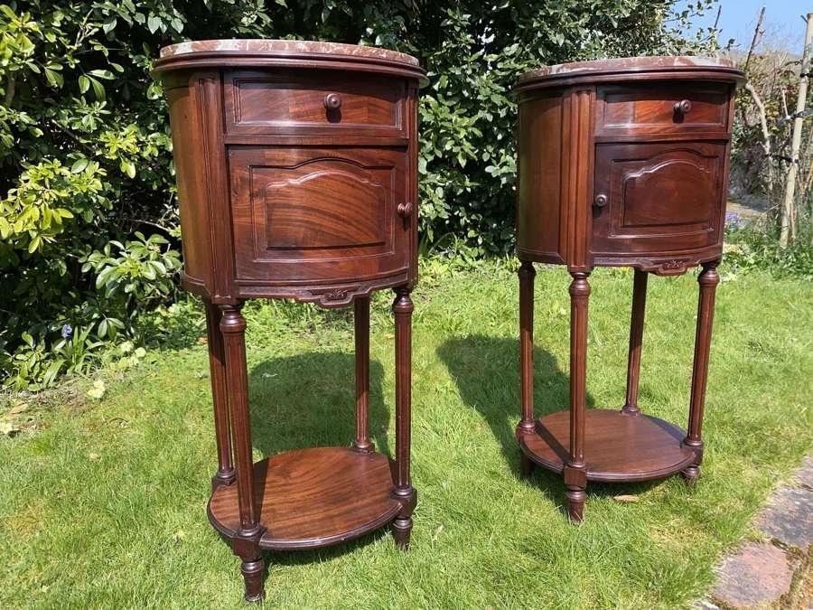 Pair of circular mahogany bedside tables