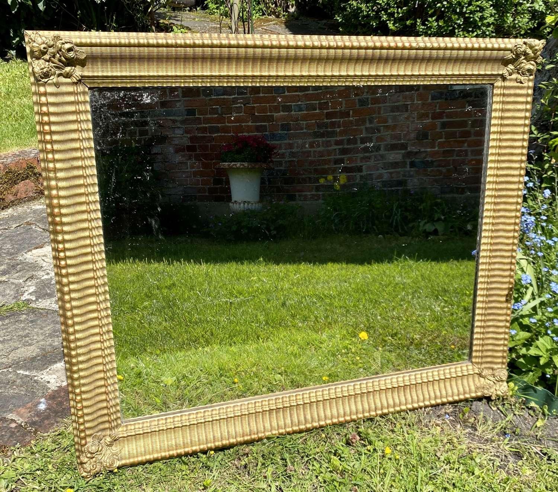 19th Century rippled mirror in gilt