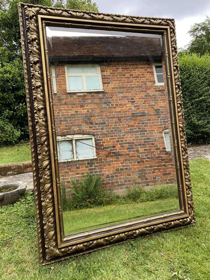 Very large gilt cushion mirror