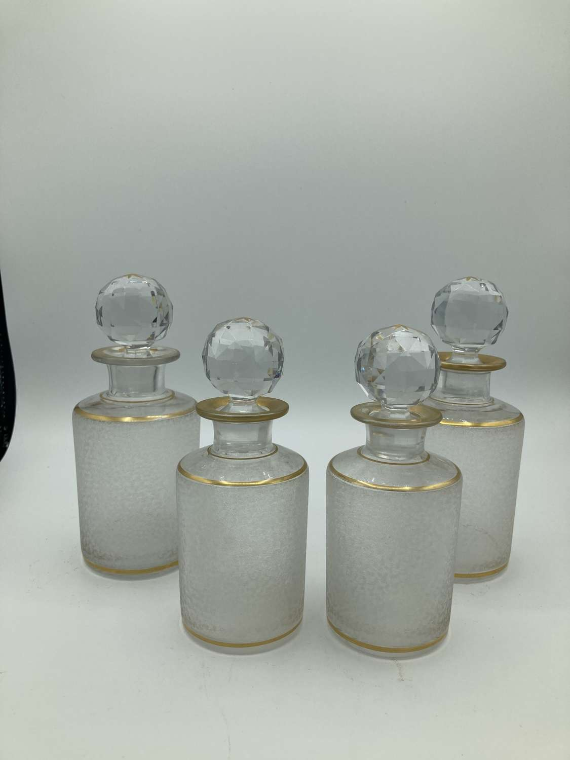 A Set Of 4 French Perfume Bottles