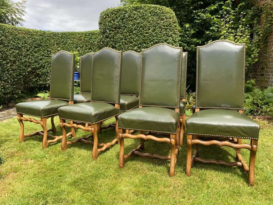 Set of 8 green leather dining chairs