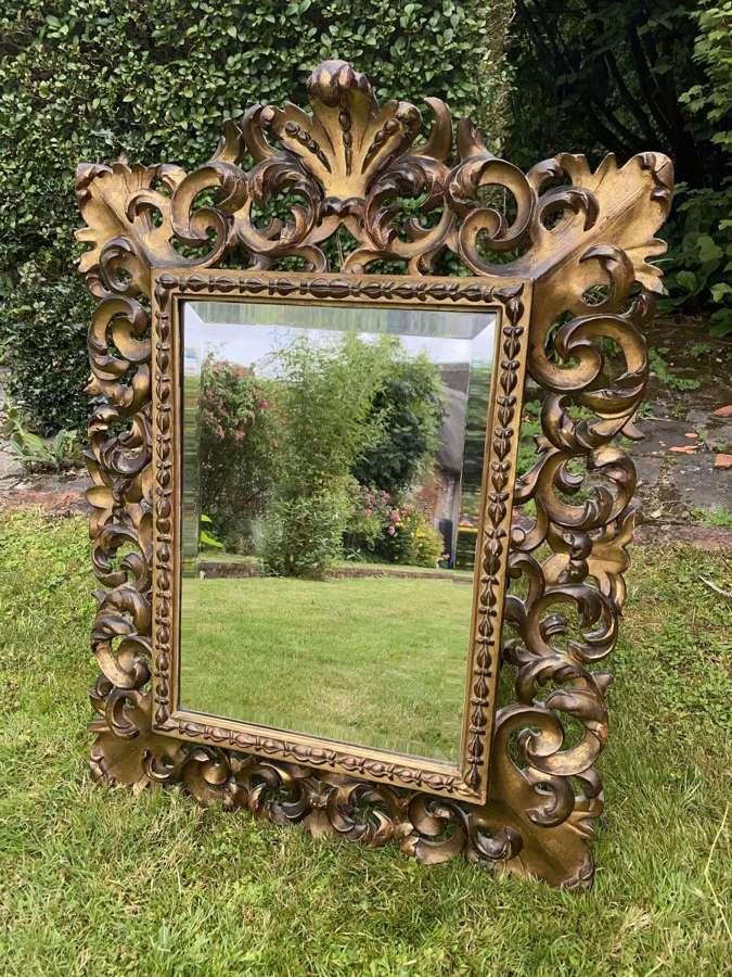Carved giltwood florentine mirror