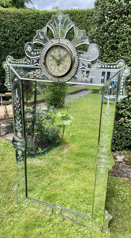 Unusual Venetian mirror with integral clock
