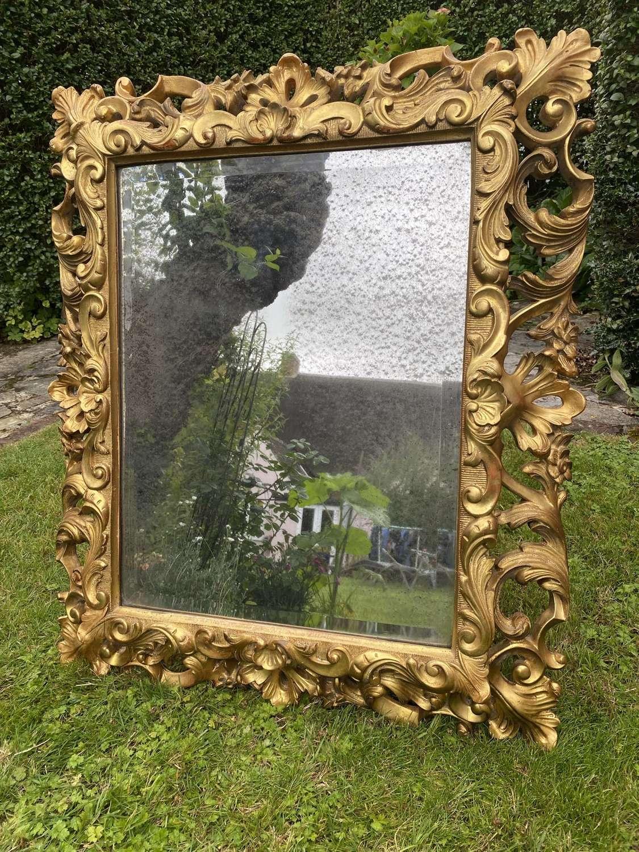 Carved giltwood cushion mirror