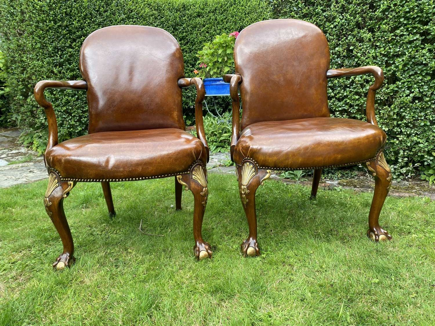 Pair of leather and gilt armchairs